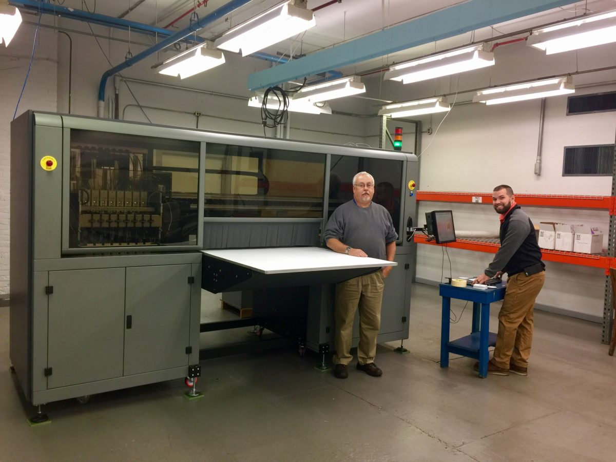 Dave Kutchenriter and Derrick Beck with Ohio Art, testing out the new Digital Press.